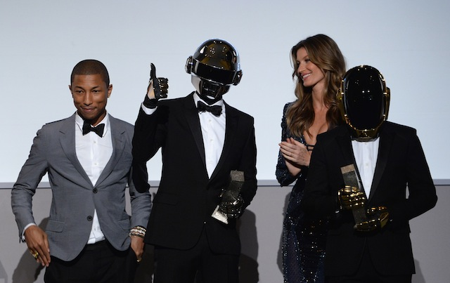 Pharrell Williams and Gisele Bündchen present an award to Daft Punk onstage at the WSJ. Magazine's 'Innovator Of The Year' Awards 2013 at The Museum of Modern Art on November 6, 2013 in New York City