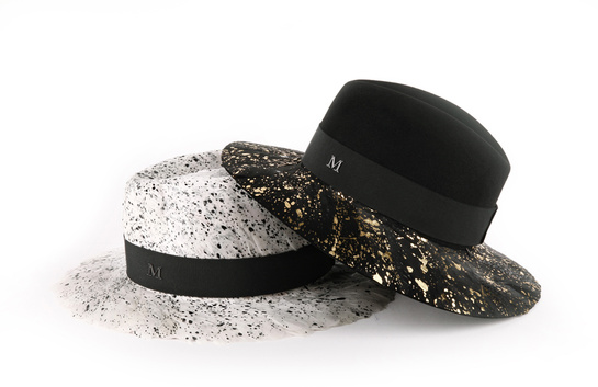 André medium felt and Lemarié feather trilby, €1352. Henrietta felt trilby with large Lemarié feather brim, €728