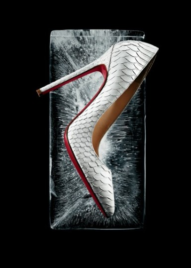 "Christian Louboutin ""Pigalle"" point-toe pumps in white python. $1,345"