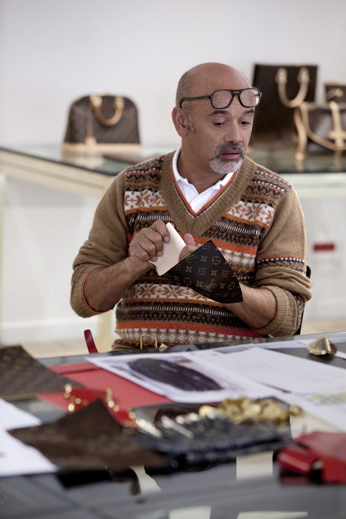 Christian Louboutin clutches a morsel of monogram