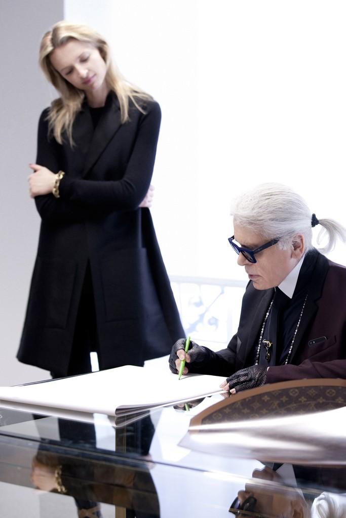 Delphine Arnault observes Karl Lagerfeld sketching